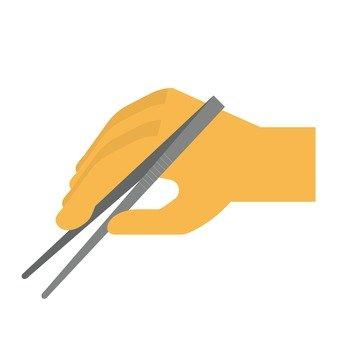 Hand with tweezers