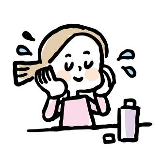 화장수를 붙이는 여성