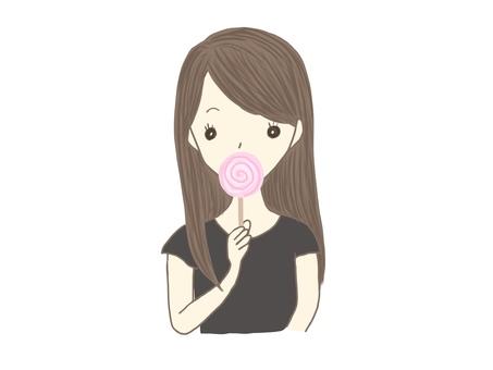 舔糖果的女人