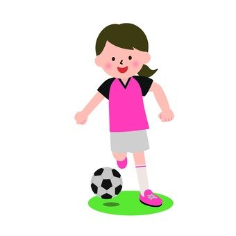 A girl kicking a soccer ball