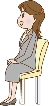 A woman sitting in a chair