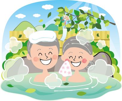 Fresh green summer hot spring open-air bath elderly people rock bath empty