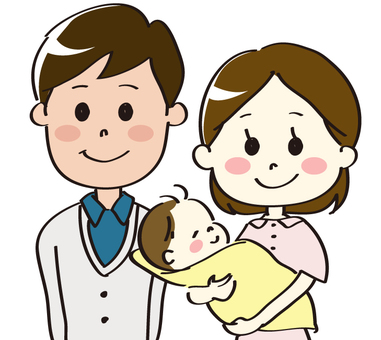 A couple holding a baby