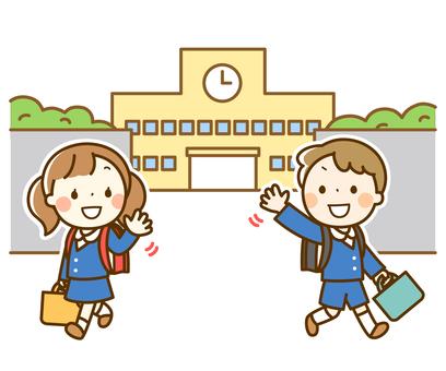 小学校から下校する男の子と女の子