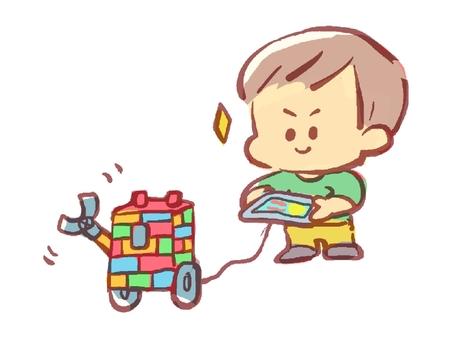 A boy manipulating a robot by programming