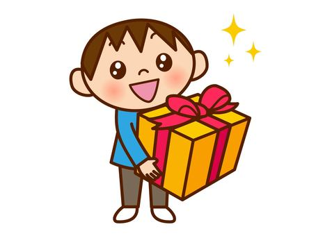 A boy holding a present