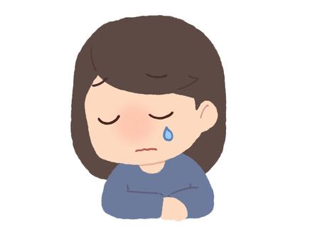 A woman shedding tears