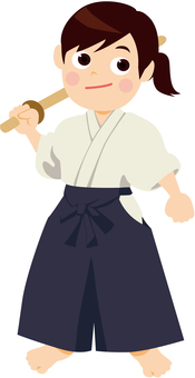 A woman with a hakama with a wooden sword