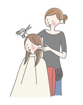 Woman cutting hair in a beauty salon