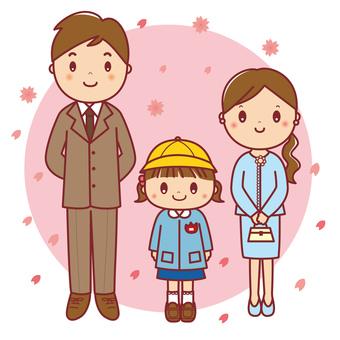 卒園・入園 女の子の園児と両親