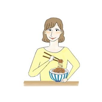 Girl eating natto rice for breakfast