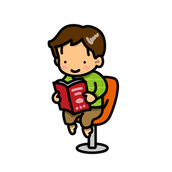 A boy sitting in a chair and reading a book