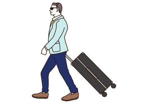 가방을 끄는 남자