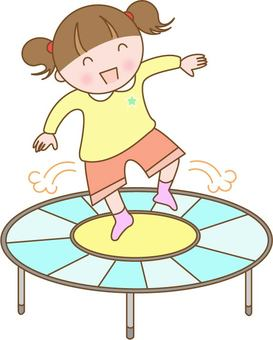 Children playing with trampoline