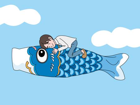 A boy on a carp streamer 2