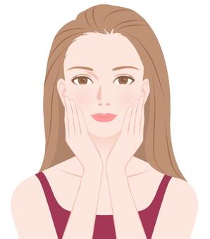 頬を触る女性1
