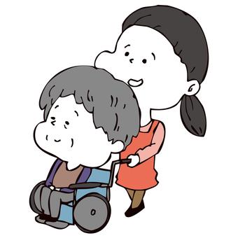 車いすを押す介護士女