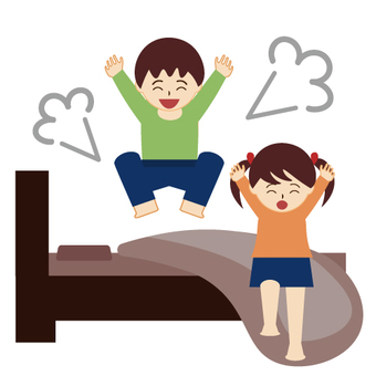 Boys and girls jumping in bed