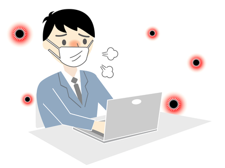A man in a suit wearing a mask and using a computer