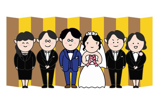 Wedding smiles in front of a golden screen