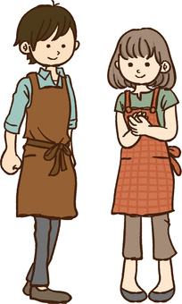 A man and a woman in an apron
