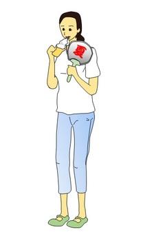 A woman eating a soft cream