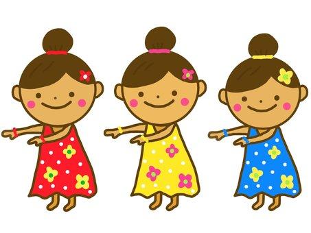 Three girls dancing hula dance