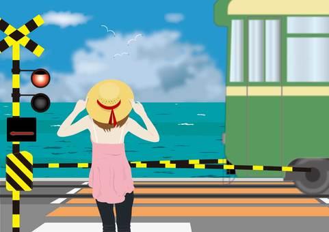A girl waiting at a railroad crossing