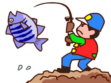 A man who caught a big sea bream at the sea