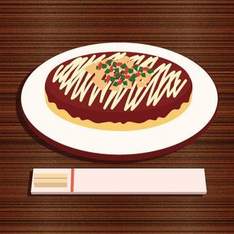 Okonomiyaki放在桌上的圖像