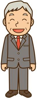ニコニコ笑顔のスーツの中年男性