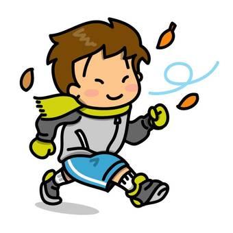 Boy running under the autumn sky