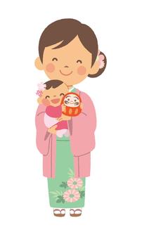 媽媽和寶寶與陽光明媚的衣服