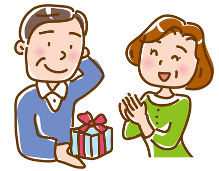 Husband hands over to his wife while giving a present