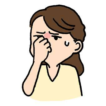 A woman who pinches her nose because it smells