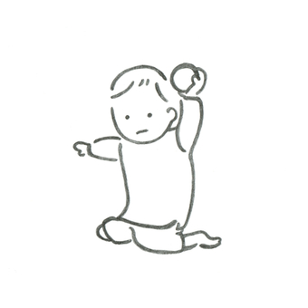 An infant playing with a ball