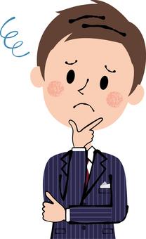 Male suit thinking fingers in jaw Men suit deep blue