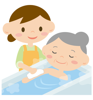 A woman helping with a grandma taking a bath