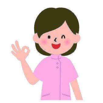 Medical - Female nurse who signs for OK (upper body)