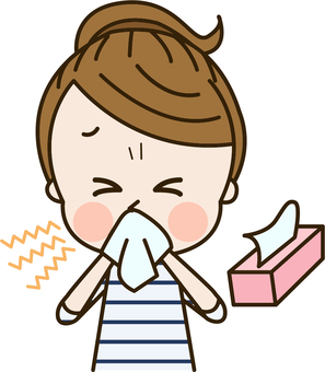 A woman biting her nose with a tissue