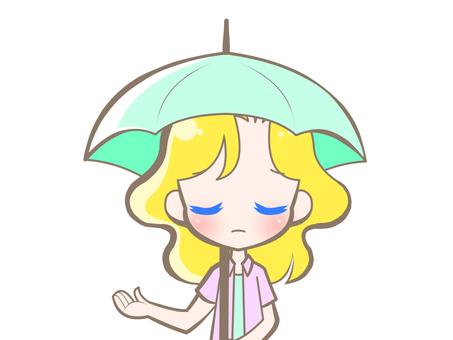 有傘的白種人婦女哀傷