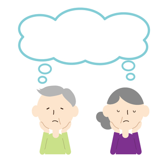 Senior couple holding a cane with speech bubble