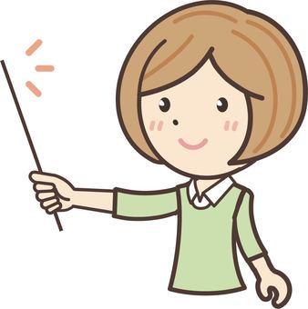 A woman wearing a shirt that has an instruction stick