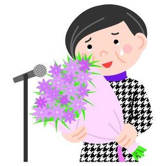 Veteran women holding a bouquet with a speech