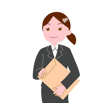 Woman in suit with brown envelope