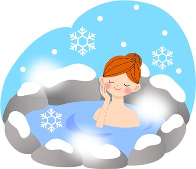 A woman entering a hot spring
