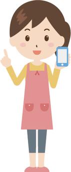 Woman | housewife | apron | smartphone