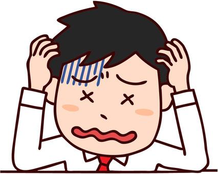Male businessman holding head