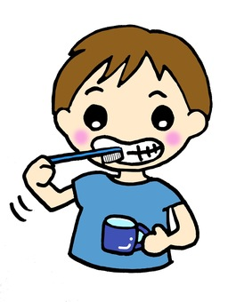 A boy brushing her teeth