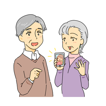 A couple looking at grandchildren in a smartphone